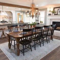Joanna gaines kitchen kitchen table chandelier over dining table magnolia. Dining Room Fireplace, Dining Room Table, Dining Area, Kitchen Dining, Kitchen Decor, Wood Table, Dining Chairs, Dining Rooms With Fireplaces, Table Legs
