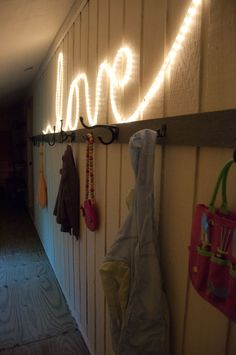 Simple rope lighting formed into a cursive word, would be great in a teen room...