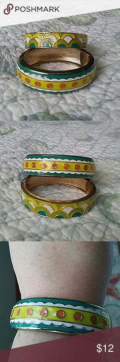 """🌷Sale Bangles Two bangles. Teal white orange yellow. Teal white lime green & yellow. Magnetic close. Oval shape. My wrist is 7.50"""" & they're a little snug. Jewelry"""