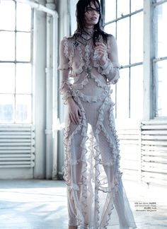 Rianne models a silk lace, ruffle dress from Alexander McQueen