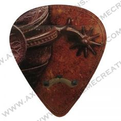 "New patent pending, Western Themed- Giant guitar pick shaped , wall mounted guitar hanger . This is available with, or without a String swing hanger. If you already have a String Swing hanger, you do not need to buy the kit!! It is only three easy steps in less than a minute to give your boring wood block a touch of class:  SIZE: 13"" tall x 11-1/4"" Wide x 1/4"" thick  (Hanger is 5-1/4"" deep off of the wall once fully installed.) Perfect  for your shop, store, or your studio!"