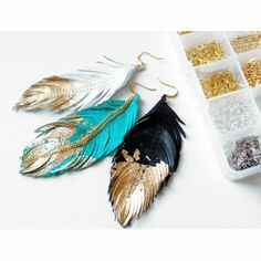 Leather Feather Earrings by Love at First Blush $42