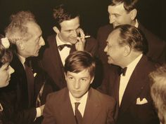 Jean-Pierre Leaud surrounded by Jean Cocteau, François Truffaut and Edward G.Robinson at the Cannes film festival in 1959.