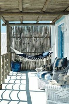 39 Wonderful Sea And Beach-Inspired Patios : 39 Cool Sea And Beach Inspired Patios With White Blue Wall Sofa Pillow Chair Hanging Bed Table And Hardwood Floor With Wooden Ceiling And Beach View #xmas_present #Black_Friday #Cyber_Monday