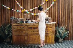 DIY pom poms and dried wildflowers, capture the rustic and fun atmosphere that we love!