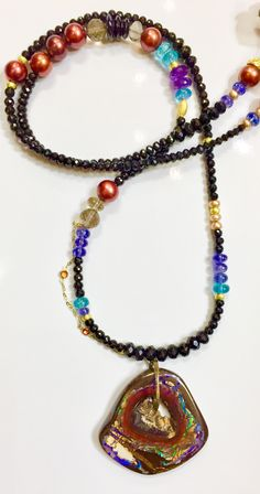 Jennifer Kalled; Yowah opal pendant on a cornucopia of gem beads.  Opal from Bill Kasso www.kalledjewelrystudio.com