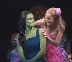 "This is so funny. You can see Idina mouth: ""Ow!"" This her and Kristin Chenoweth as Elphaba and Glinda in Wicked during Glinda's song Popular."