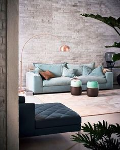 sofa, chaise and bronze floor lamp