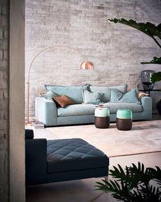 sofa, chaise and bronze floor lamp