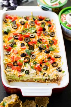 Looking to make a better Mexican 7 layer dip than anyone else? Us too and we've got a secret in one layer that you'll love! 7 Layer Bean Dip, 7 Layer Taco Dip, 7 Layer Dip Recipe, Layered Taco Dip, Seven Layer Dip, Best Party Appetizers, Appetizers For A Crowd, Appetizer Recipes, Mexican Appetizers