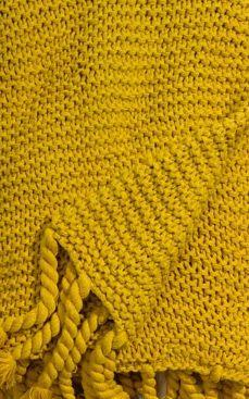 Yellow knit throw blanket.