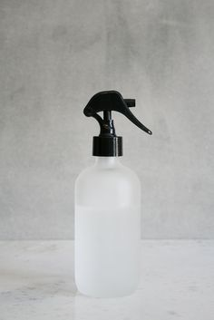 This small frosted glass misting bottle with black spray nozzle is perfect for natural homemade linen sprays, cleaners, misting plants, and for ironing!