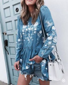 Embroidered Floral Pattern Denim Shirt Dress Teamed With Denim Shorts And A White Leather Bag