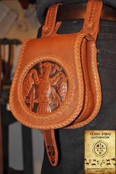 Handmade leather pouch with leather lacing and embossing. The falcon with the nestlings were traditional symbols in the ancient hungarian beliefs.
