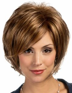 Carmen Wig by Estetica Designs. This beautiful short style ia a wispy layered bob with side swept bangs and soft curls in the back