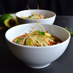 Tortilla Soup topped with Avocado, Cotija Cheese and Tortilla Strips.