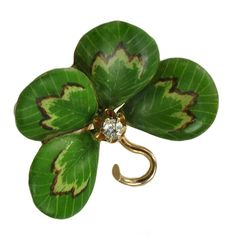 A gold, enamel and diamond brooch, c.1905, in the form of a lucky four-leaf clover. (Jacob's Diamond & Estate Jewelry/collectorsnet)