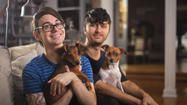 Christian Siriano, with dog Bear (left) and Brad Walsh, with dog Topper (right) in Christian's New York apartment