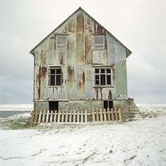 love the pale washed out color of this rustic beach shack