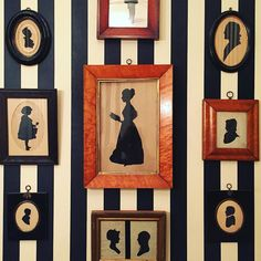 From a Westchester powder room. A collection of silhouettes that are particularly fetching on a black and white striped wallpaper.