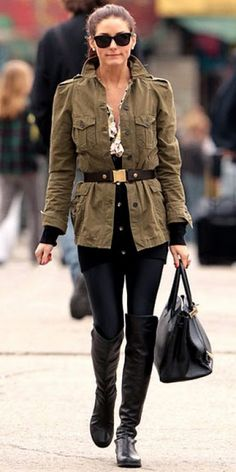Military jacket with black tights and tall boots.