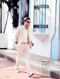 Shaun DeWet photographed by Arnaldo Anaya-Lucca and styled by Jacky Tam with suits from Alexander McQueen, Tom Ford, Hermès and more, for this Miami Vice inspired editorial for the latest issue of GQ Japan.