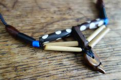 Black waxed cord macrame necklace with bone plastic and wood