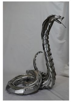 This King Cobra sculpture is slithering off to Madrid tomorrow. Made by Hubcap Creatures