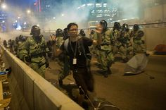 Umbrella Revolution Hong Kong, Demonstrators disperse as tear gas is fired by police during a protest on September 28, 2014 in Hong Kong. Thousands of people kicked off Occupy Central by taking over Connaught Road, one of the major highway in Hong Kong, in protest against Beijing's conservative framework for political reform. (Photo by Anthony Kwan/Getty Images)
