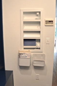 In wall charging station for mobile devices.