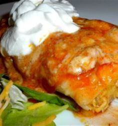 Enchiladas - per a review, put chicken (can use frozen breasts/ thighs) in crockpot with taco seasoning, the garlic, onion, & chili powders, chopped onion & a little water in the morning. After work, shred chicken, add the other filling ingredients to the crockpot and stir. Assemble as directed. Can use green sauce instead of red. 15 min prep for the oven and the meat tastes great from simmering all day in the spices.