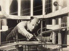 Lissitzky working on the maquette for the set of V.E. Meyerhold's production of the play I Want a Child by S.M. Tretyakov 1928. © The State Tretyakov Gallery, Moscow. Image courtesy of Fundació Catalunya La Pedrera.