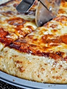 Garlic Bread Pizza Crust (makes one pizza) 1 1/8 cups warm water (100-105 degrees) 3 teaspoons active dry yeast 1 1/2 tablespoons honey 1 1/2 tablespoon olive oil 3 cups all-purpose flour 1 teaspoon salt 1 teaspoon garlic powder 1 teaspoon dried basil 5 tablespoons unsalted butter 2 garlic cloves, pressed or very finely minced 2 tablespoons parmesan cheese