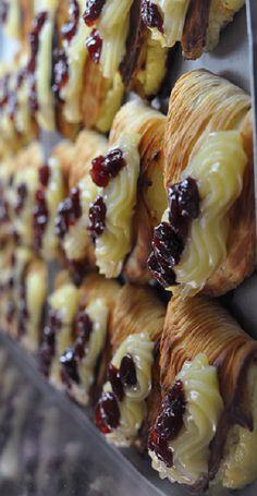 sfogliatelle napoletane con crema e ciliege di vignola...translation: These pastries are called Sfogliatelle and are my fave!