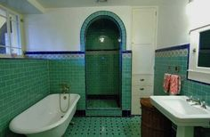 I'm interested in the continuously tiled walls and floors, the tiled archway of the shower area, the built-in linen closet, the high windows (low windows creep me out in a bathroom), subway tiling for the walls, and, of course, a claw foot tub.