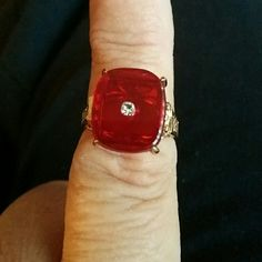 Square red ring New, gold plated ring, size 7, antique look band, square red stone the color of a ruby with single clear stone in the middle. Will bundle. Jewelry Rings