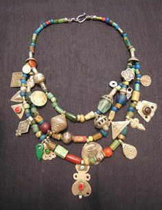 ancient Roman glass  beads, 1800BC-350BC, made from pottery found by farmers in Balkh,  also known as Bactria, one of the world's oldest cities, in present-day  northern Afghanistan. Small glass beads and silver Berber pendants  from Morocco. Carnelian, silver, and glass beads, pendants, and dangles  from the Turkoman, Sindhi, and Uzbek peoples. Chinese green glass  beads. Indonesian Java beads.