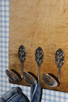 spoon hooks. Good display idea for a knitting tea room. Could hang knitted garments on hangers from them.