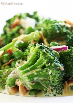 Broccoli Salad by simplyrecipes: Blanched fresh broccoli tossed with toasted almonds, bacon and peas, topped with a homemade honey vinegar dressing. A favorite picnic salad. #Salad #Broccoli #Healthy