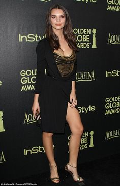 Black and gold: British born model and actress Emily Ratajkowski made a memorable appearance at Los Angeles restaurant Fig & Olive on Thursday evening