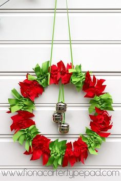 Christmas ribbon wreath - no instructions but it appears to be lengths of ribbon tied in knots around a wire wreath form with bells hanging from the middle.