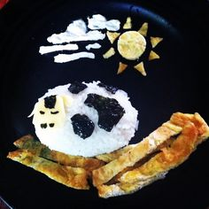 """Here's one of my many first """"bento"""" made for my daughter...sheep lying on her bed of scrambled egg...sheep made out of rice molded using glad plastic wrap.. Sheep's details are all made out of nori and cheese. Mr. Sun from scrambled egg and the clouds from Oreo cream filling :)"""