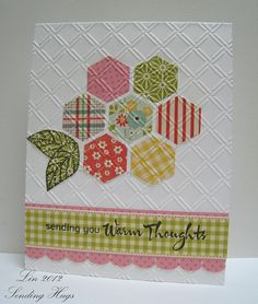 hexagon quilt flower on a delightful card...luv the selection of patterned papers with the look of fabric prints...