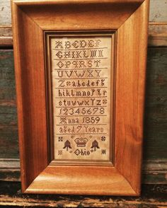 Handmade sampler.   Designed and stitched by Dan Weaver-White.