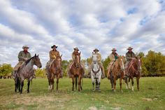 Cowboys and Cowgirls in a row Sitting on their Horses, Shell, Wyoming, USA - 600-08082917 © Martin Ruegner Model Release: Yes Property Release: Yes Cowboys and Cowgirls in a row Sitting on their Horses, Shell, Wyoming, USA