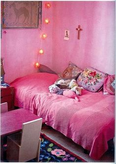This pink is not normally me but I love the whole effect of this child's room with its rich touches in the cushions, mat and picture.