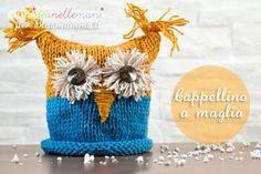 Tutorial con foto e spiegazioni per fare un simpatico cappello a maglia per bambini. Ideale per tenere al caldo, simpatico come accessorio moda.