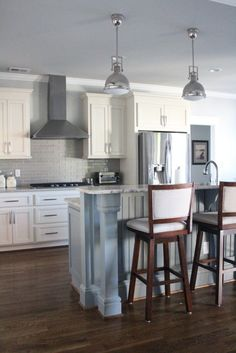 I love Repose Gray by Sherwin Williams and Sea Salt by Sherwin Williams! Pure White also by SW is a great white! The color of the kitchen cabinets and living room built-ins​ is Antique White by Sherwin Williams #6119. They have a grayish brown glaze on them.