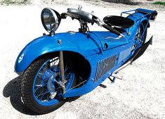 STRANGE OLDE MOTORCYCLES - OLDE BLUE RACER - HUGE FRONT SPOT LIGHT - STREAMLINED BODY!