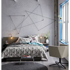 Forget the bed linens! Check out the freaking awesome wall art made with hooks and string! So clever. | CB2